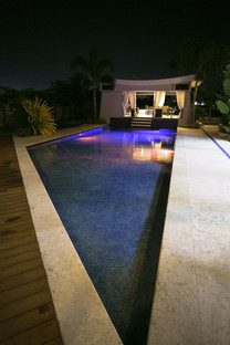 angle pool with teak & shell stone pool deck, thin runnel