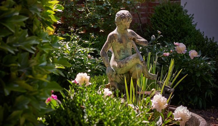 garden statue, boxwoods & perennials