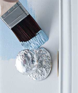 Before painting, wrap doorknobs in tin foil. The foil molds to the door handle to protect it from paint. So smart!