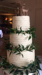 buttercream cake with foilage