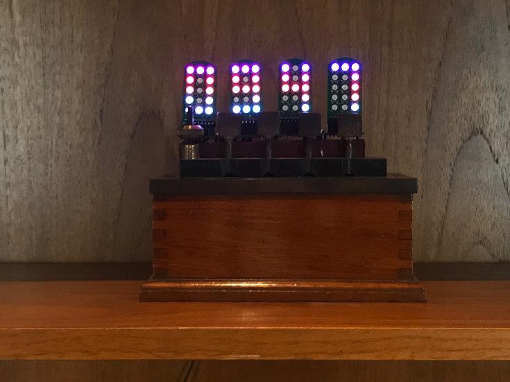 4 Digit Plug in Full Colour 7 segment display clock in a Resistance Box