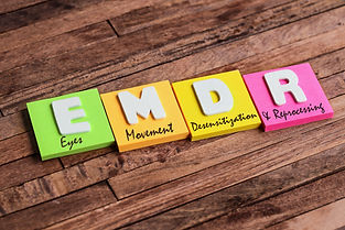 Colorful square papers with wooden white letters for the English acronym word, EMDR.jpg