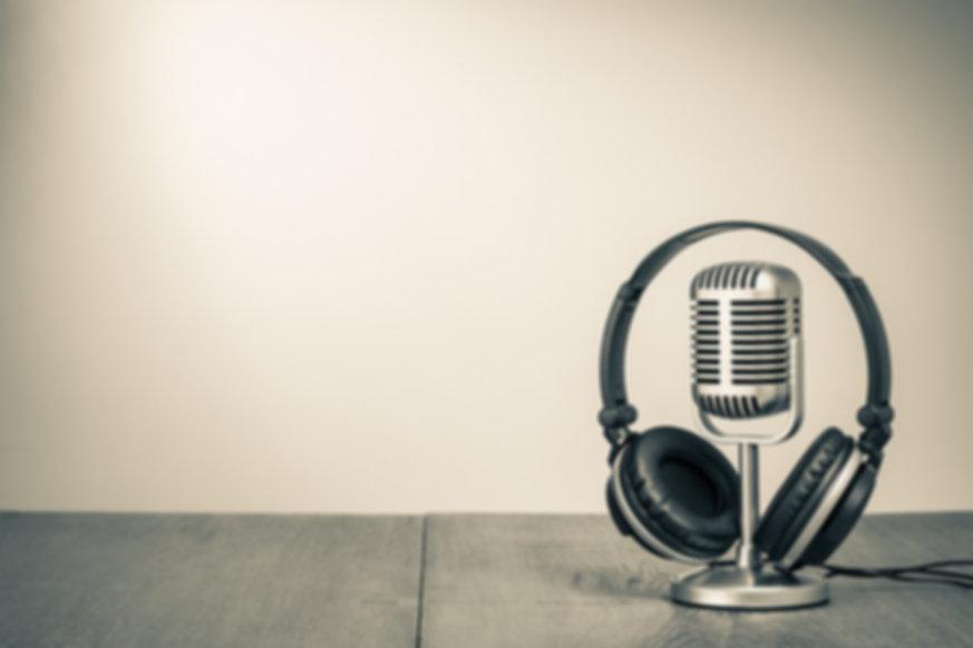 Retro microphone with headphones on tabl