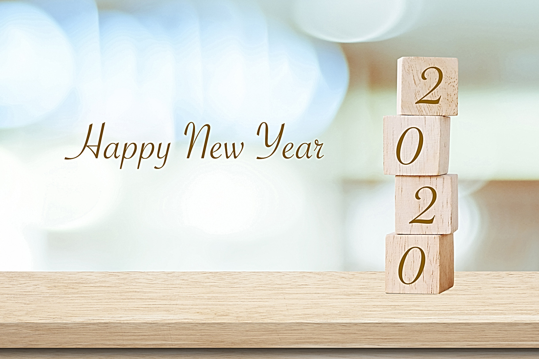 Happy New Year 2020 on wood cube block a