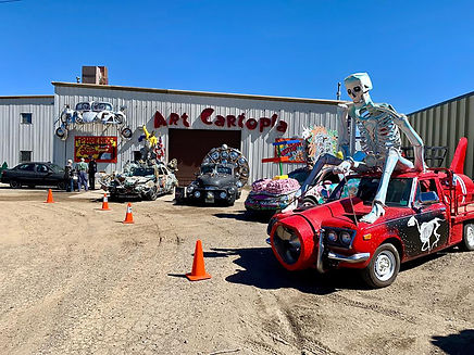 Artocade Museum with art cars parked outside