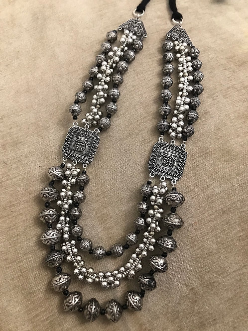 Long oxidized beaded necklace
