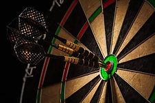 34457336-three-darts-in-bull-s-eye-close