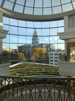 View of the Capitol building in Denver from inside the Colorado Supreme Court Atrium