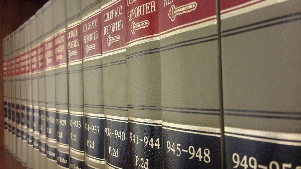 Colorado Reporter books stacked on a bookshelf