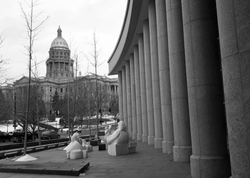 Capitol building in Denver Colorado with the pillars of the Colorado Supreme Court Courthouse in the