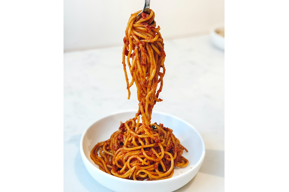 Bowl of spaghetti noodles being twirled onto a spoon