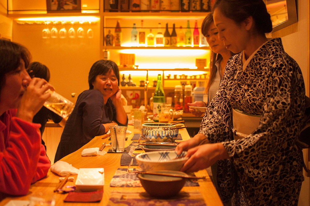 Sushiyone's okami serving bar food at this local Syu's bar