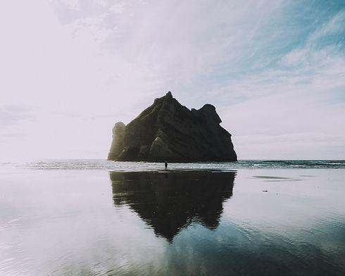 Far Shot of Man Near Rock.jpg