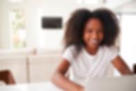happy-young-teenage-black-girl-using-lap