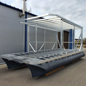 Boat hull made using plastic pontoons and welded construction aluminium frames.