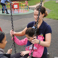 Martina exploring the swings during neur