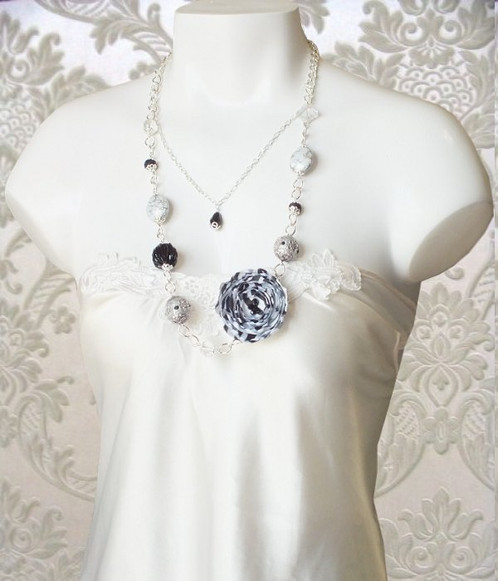 Statement black and white fabric flower necklace unique handmade the black and white satin fabric flower gives this statement necklace a classic touch the designer beads make it exquisite a black and white accessory mightylinksfo