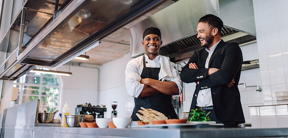 restaurant owner and cook smiling