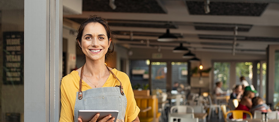 photo of small restaurant owner smiling