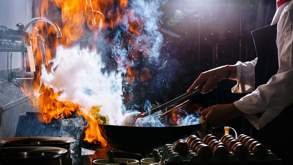Close up shot of cook flaming food