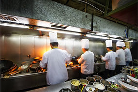 Cooks in kitchen silver franchising innovative eats