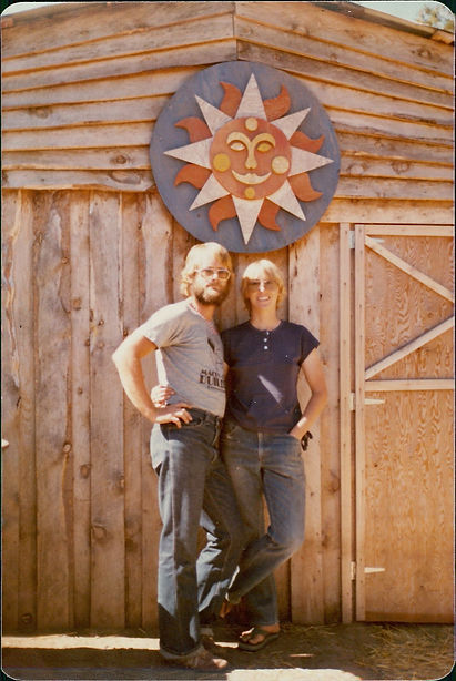 Tom and Penny in front of new barn.jpeg