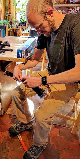 Aaron making a first broom.jpeg