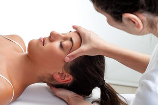 Close up of osteopath doing healing trea