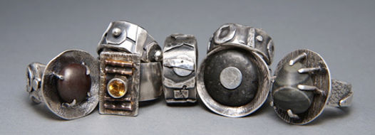 A variety of sterling silver, copper and stones are incorporated into these rings.