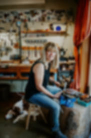 April Ottey Jewelry Artist woking in her studio