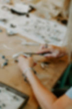 Close up of April Ottey Jewelry Artist working in the studio
