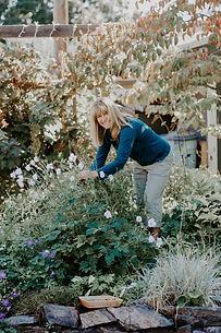 April Ottey Jewelry Designer in her garden