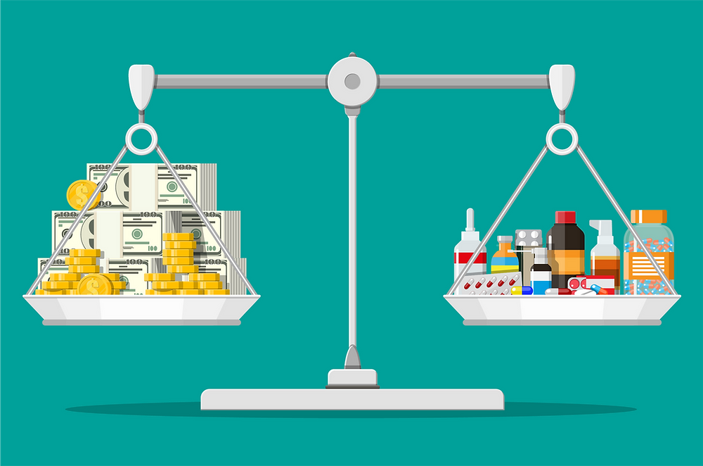 Scale balancing money and prescription drugs.
