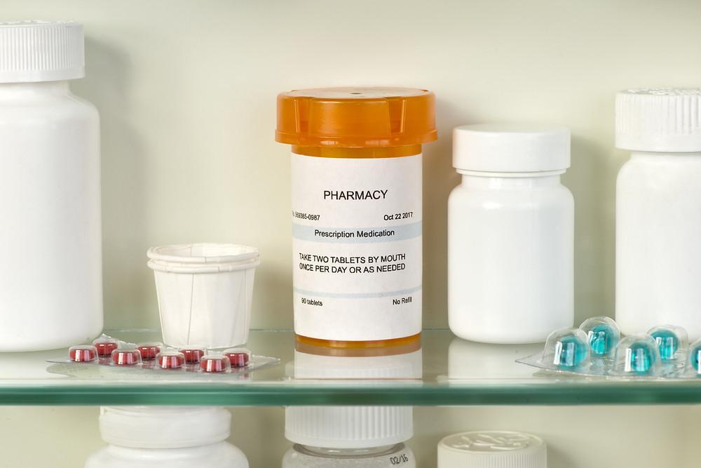 Prescription medications on shelves.