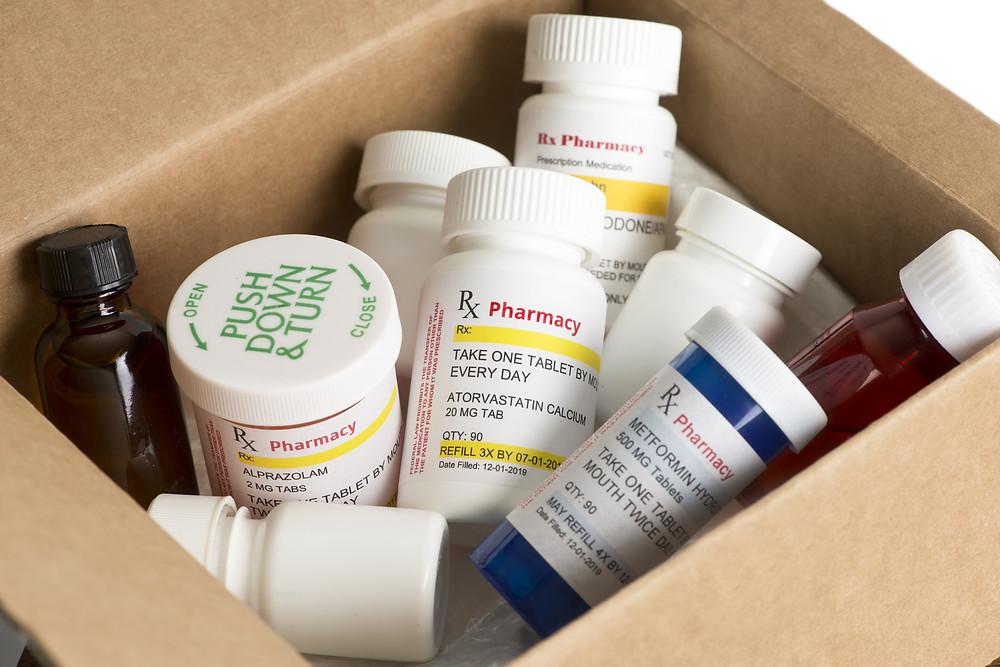 Prescription medications in a shipping box.