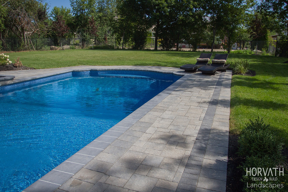 Patio Pavers by Oaks Concrete Products around a vinyl pool. Quality Material for those 7000 square foot jobs.
