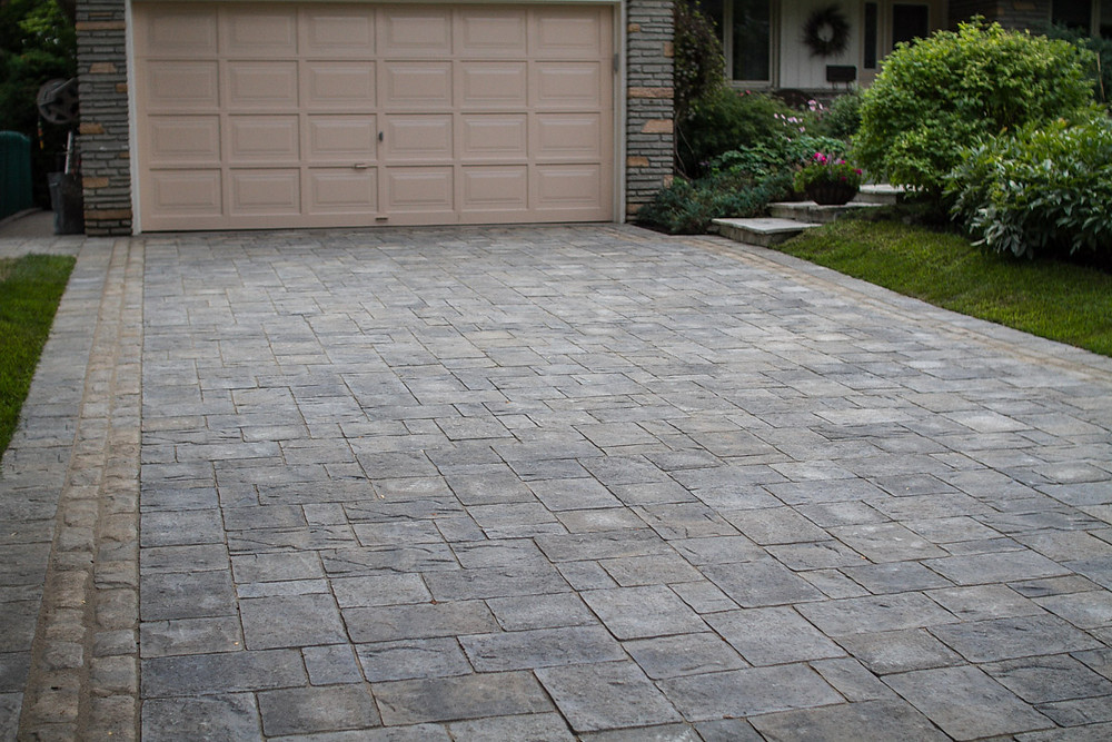 Driveway Interlock Material By Permacon. This driveway is on a concrete base and does not get ruts or weeds. Amazingly built for amazing customers.