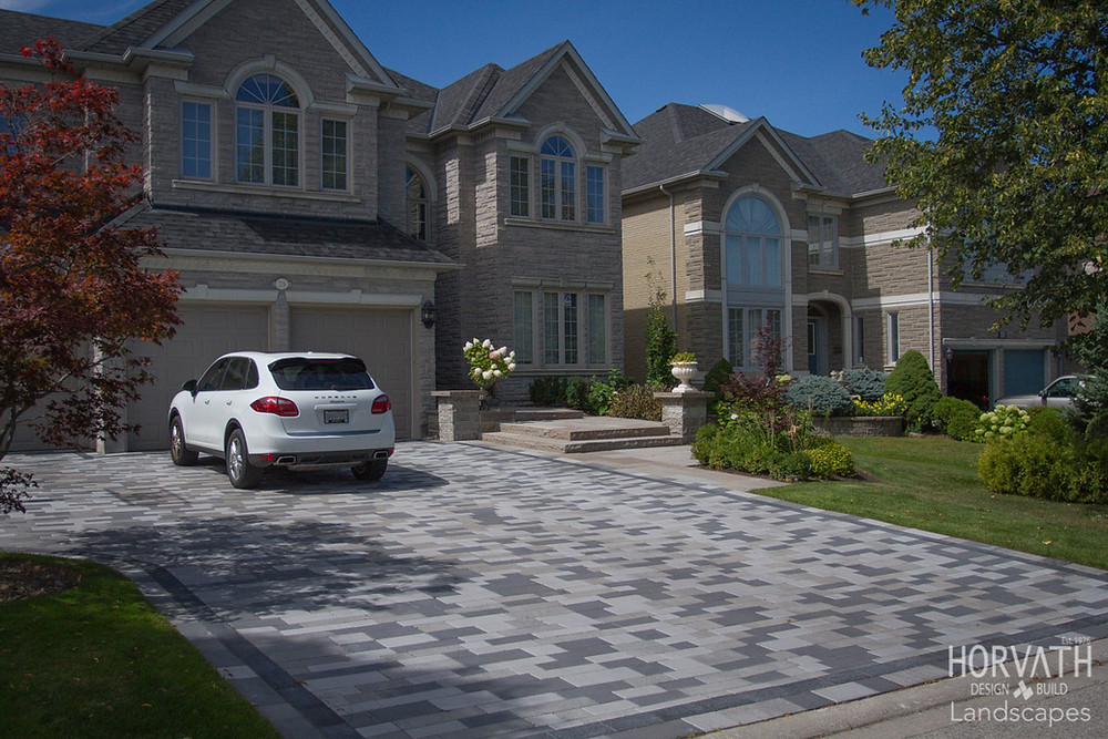 Driveway built using very high end Unilock Driveway Pavers. First thing you see when you come home is the driveway. Nice!