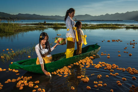 Offerings on lake Batur by young Balinese girls in the early morning