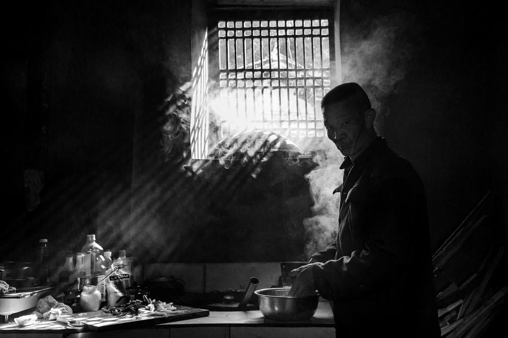 a man in his kitchen yunnan province de