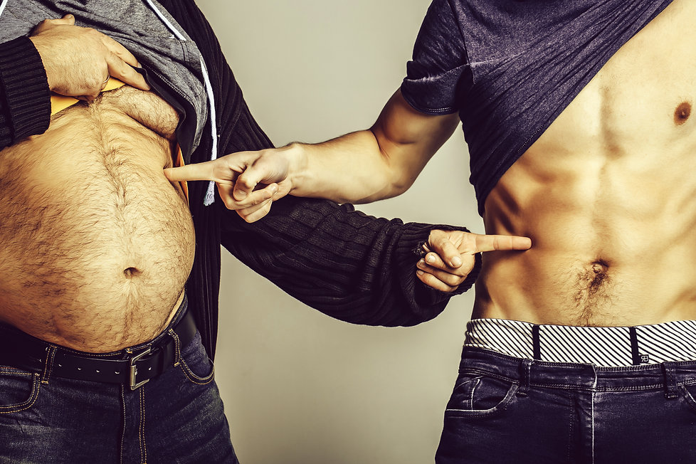 Fat belly and muscular torso of two men.