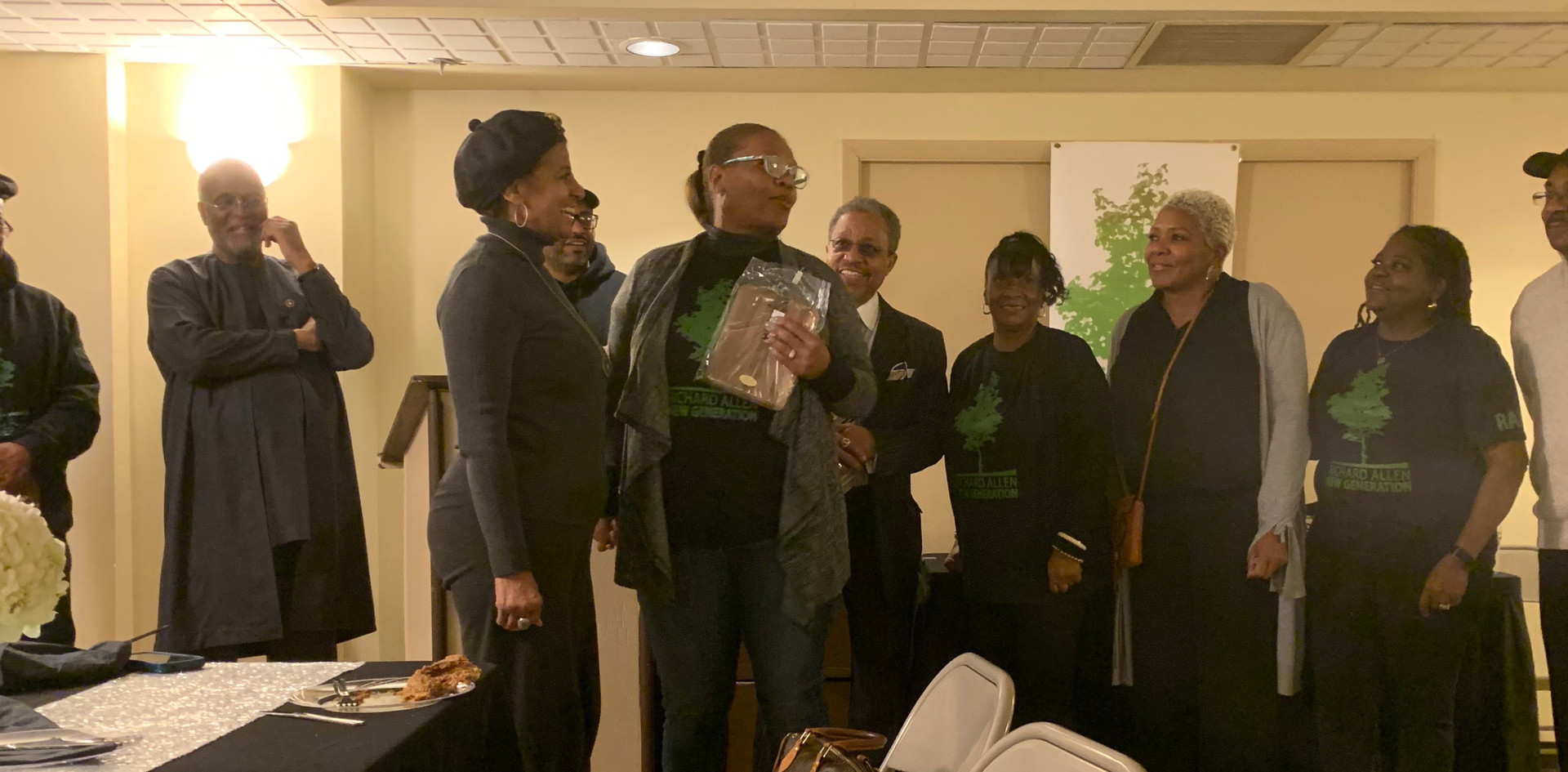 Patricia Marshall Harris, administration director, M3M,(third from left), receives a surprise appreciation award from RANG board members and officers, at the recent Recognition Dinner for the first class of graduates of the RANG/Post Brothers Pre-Apprenticeship Training Program, held recently at the Gladys B. Jacobs Manor, at 1100 Fairmount Avenue.