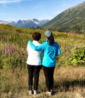 shutterstock_two women on mountain_edited.jpg