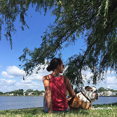 Laura Koss is sitting at Wreck Pond in Spring Lake, New Jersey with her bullog Bruno