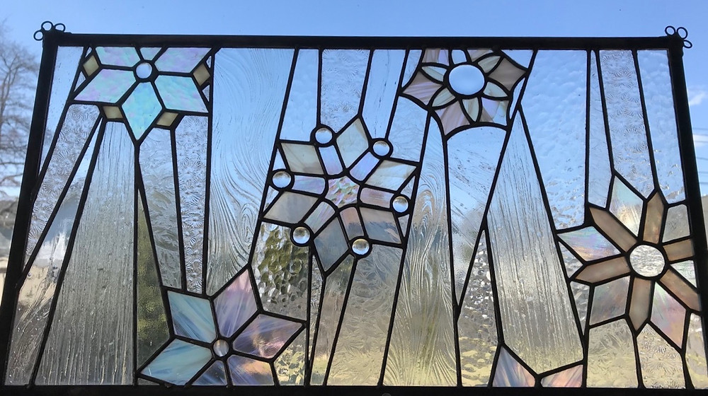 Stained glass snowflakes by Laura Koss of Garden State Glasswork