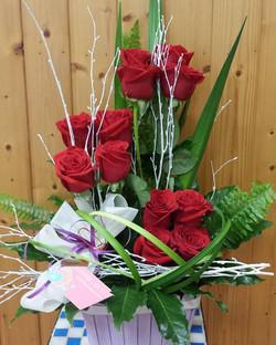 Centro 12 rosas rojas elegante