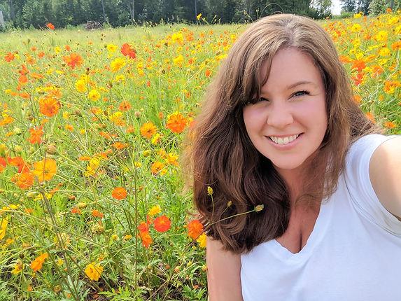 kim Lindsay in flowers_edited.jpg