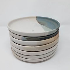 A stack of handmade horizon plates by Clay by Design.