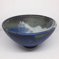 Universe bowl made by Clay by Design, glazed in earth tones with a splash of milky way white.