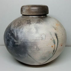 A handmade pit fired urn, by Clay by Design.